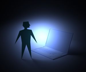 Image of a man with a laptop
