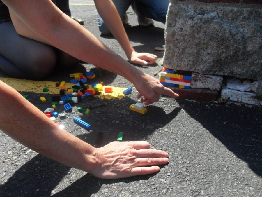 Inserting Lego bricks into the foundation of the Montserrat art school's Hardie Building